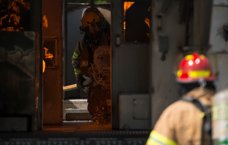 Firefighters assigned to the 628th Civil Engineer Squadron put out fires on a mobile aircraft fire training unit May 27, 2019, at Joint Base Charleston, S.C.