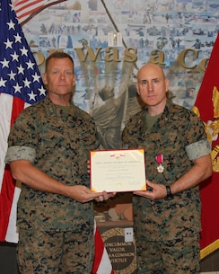 Colonel Charles M. Long, director, Weapons Systems Management Center, MARCORLOGCOM, receives Legion of Merit medal.  Major General Joseph F. Shrader, commanding general, MARCORLOGCOM presented Colonel Long with his medal in a ceremony held May 29. The medal was awarded for exceptionally meritorious conduct in the performance of outstanding services from August 2016 to May 2019.