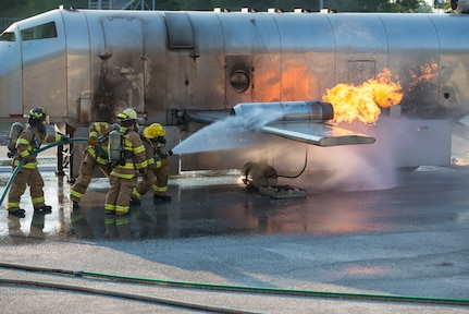 Firefighters assigned to the 628th Civil Engineer Squadron put out a fire on a mobile aircraft fire training unit May 27, 2019, at Joint Base Charleston, S.C.
