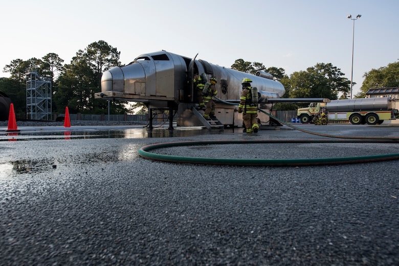 Firefighters assigned to the 628th Civil Engineer Squadron back out of a mobile aircraft fire training unit May 27, 2019, at Joint Base Charleston, S.C.