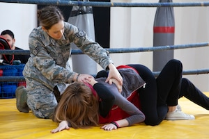 Staff Sgt. Brittany Robertson, left, teaches self-defense at a local boxing gym March 6 in Vranje, Serbia. Robertson was one of three military members who taught basic skills of self-defense to women in Serbia including how to throw a punch, situational awareness, grappling, jujitsu, and boxing. (Courtesy photo)