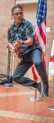 "Timothy Kanoia Kamaka performs at the Asian American Pacific Islander Heritage Month observance at Brooke Army Medical Center at Joint Base San Antonio-Fort Sam Houston May 23. Kamaka delighted attendees with his performance of Chuck Berry's ""Johnny B. Goode."""