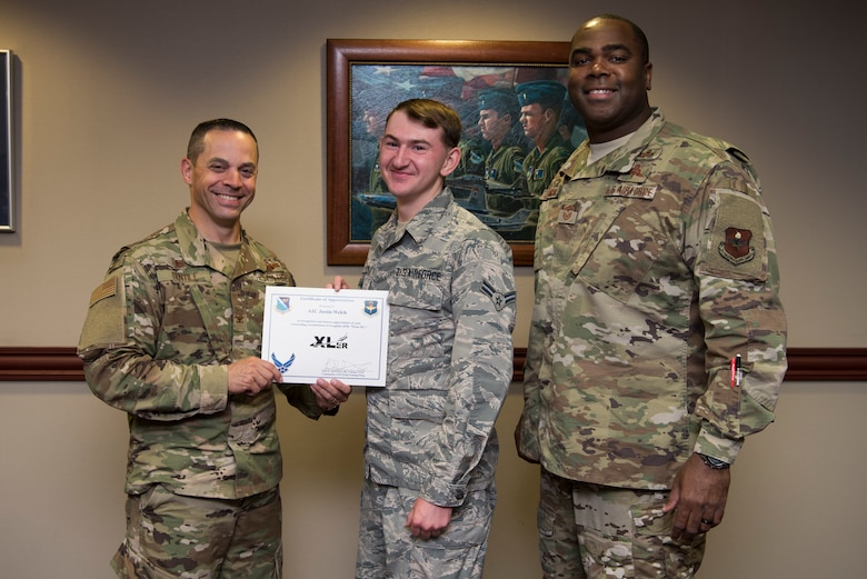 "Airman 1st Class Justin Welch, 47th Flying Training Wing Command Post emergency actions controller, was chosen by wing leadership to be the ""XLer"" of the week, for the week of May 20, 2019, at Laughlin Air Force Base, Texas. The ""XLer"" award, presented by Col. Lee Gentile, 47th Flying Training Wing commander, is given to those who consistently make outstanding contributions to their unit and the Laughlin mission. (U.S. Air Force photo by Airman 1st Class Marco A. Gomez)"