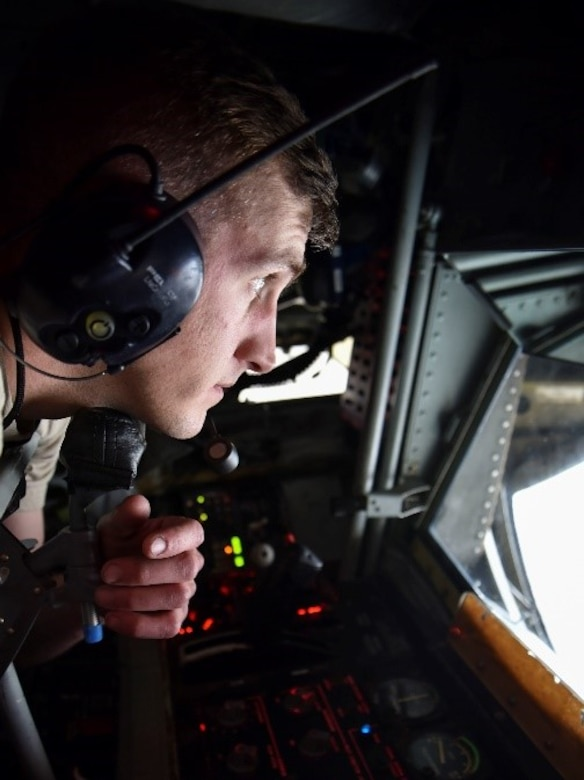 U.S. Air Force Senior Airman Jesse Weaver, 92nd Maintenance Squadron aircraft hydraulic technician, lowers the boom during an isochronal inspection on a KC-135 Stratotanker
