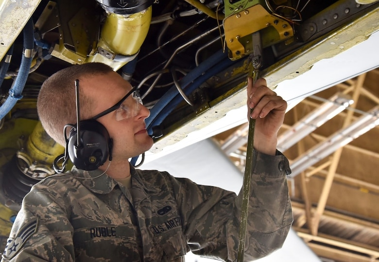U.S. Air Force Senior Airman Isaac Ruble, 92nd Maintenance Squadron aircraft hydraulic technician, checks a KC-135 Stratotanker's boom elevation limits during an isochronal inspection.