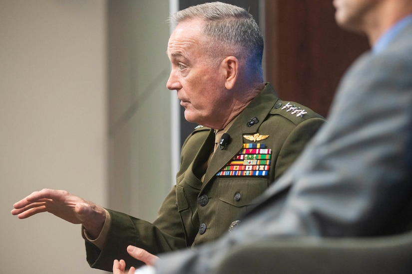 Marine general gestures while talking.