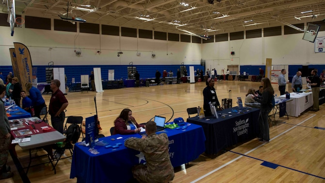 366th Fighter Wing Airmen and their families attend an education fair, May 22, 2019, at Mountain Home Air Force Base, Idaho. The fair presented educational opportunities online and across Idaho by bringing 23 schools together. (U.S. Air Force photo by Airman 1st Class JaNae Capuno)