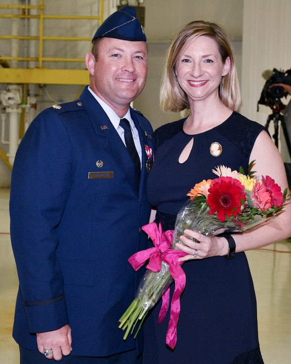 Lt. Col. Torczynski Presents Flowers To Mrs. Torczynski