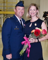 Lt. Col. Torczynski Presents Flowers To Mrs. Torczynski