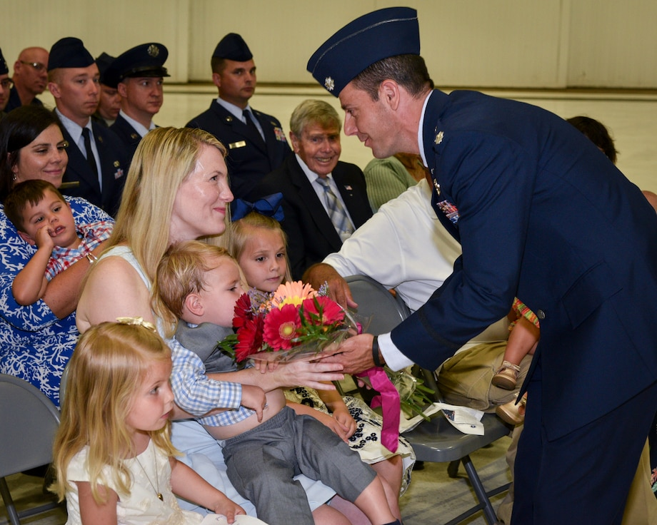 Lt. Col. Curran Presents Flowers To Mrs. Curran and family