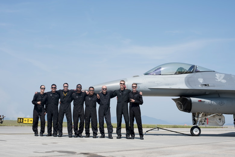 "The Pacific Air Forces F-16 Fighting Falcon Demonstration Team pauses for a photo at the 43rd Japan Maritime Self-Defense Force – Marine Corps Air Station Iwakuni Friendship Day 2019 at MCAS Iwakuni, Japan, May 5, 2019. U.S. Air Force Capt. Jacob ""Primo"" Impellizzeri, the PACAF F-16 Fighting Falcon Demo Team commander and pilot, oversees the team which consists of three crew chiefs, two avionics specialists, one electrical and engineering specialist, one engines maintainer, one superintendent and a safety observer. (U.S. Air Force photo by Senior Airman Collette Brooks)"