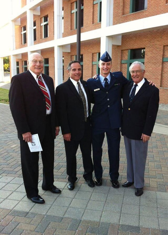 "U.S. Air Force Capt. Jacob ""Primo"" Impellizzeri, center right, the Pacific Air Forces F-16 Fighting Falcon Demonstration Team commander and pilot, pauses for a photo with retired U.S Air Force Col. George Rice, left, his maternal grandfather, and former U.S. Air Force Capt. Ken Impellizzeri, center, his father, and former Cpl. U.S. Army Air Corps Donald Impellizzeri, right, his paternal grandfather, right, after his commissioning ceremony at Wright State University in Dayton, Ohio, June 8, 2012. Post high school graduation Impellizzeri attended the Reserve Officers' Training Corps program resulting in a continued family legacy of service. (Courtesy photo)"