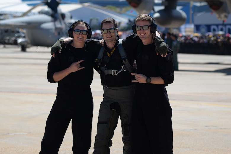 "U.S. Air Force Staff Sgt. Emily Wall, left, former lead crew chief, Capt. Jacob ""Primo"" Impellizzeri, center, commander and pilot, and Staff Sgt. Dane Pendzinski, right, crew chief, all with the Pacific Air Forces F-16 Fighting Falcon Demonstration Team, pause for a photo at the Aero India Air Show, India, Feb. 23, 2019. Impellizzeri and his team have travelled to South Korea, Alaska, New Zealand, India, Thailand, Guam, the United Kingdom and multiple Japan prefectures to promote cohesion, unity and friendship between the U.S. and its' allies. (Courtesy photo)"