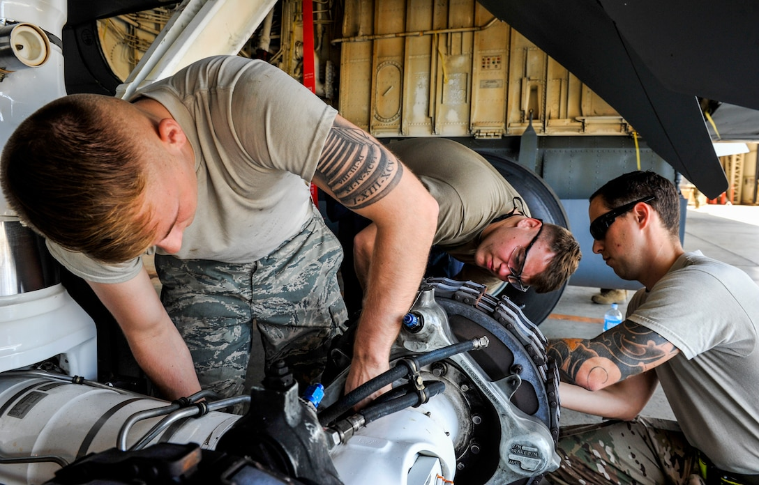 Maintainers from the 18th Maintenance Group inspect a KC-135 Stratotanker during an isochronal inspection at Kadena Air Base, Japan, May 22, 2019.