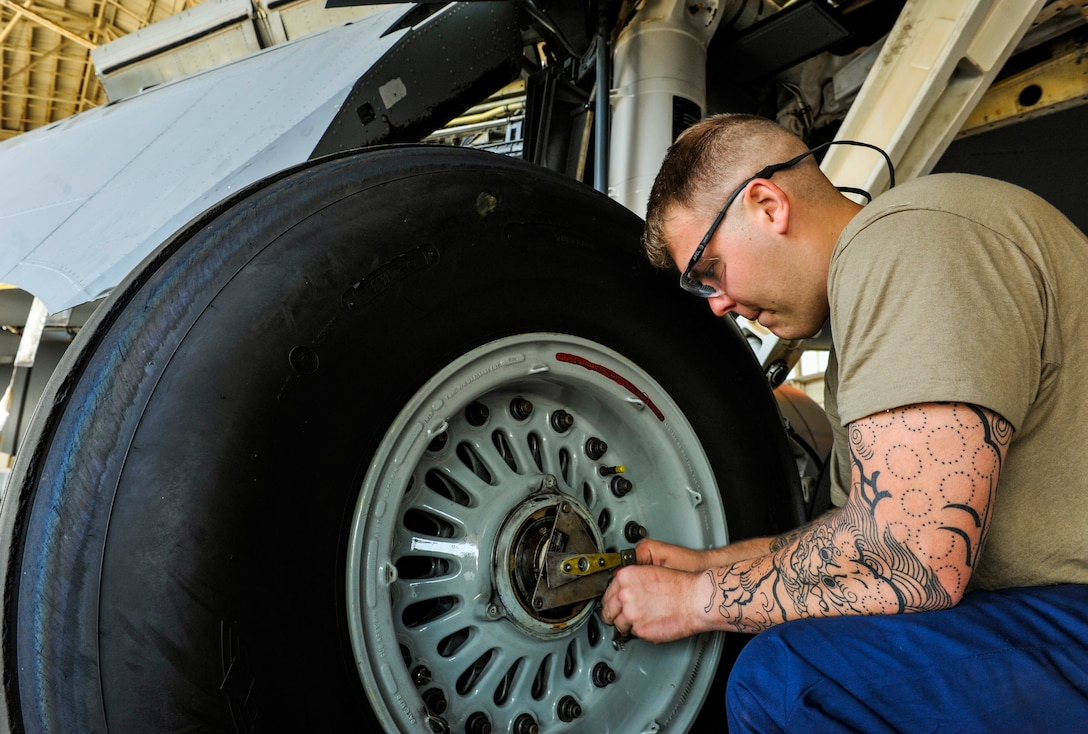 U.S. Air Force Airman 1st Class Andrew Roberts, aircraft inspection apprentice assigned to the 18th Equipment Maintenance Squadron, unscrews bolts from a wheel cap of KC-135 Stratotanker during an isochronal inspection at Kadena Air Base, Japan, May 22, 2019.