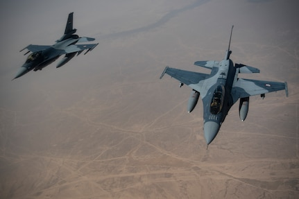 Iraqi Air Force F-16 Fighting Falcons conduct a training mission over Iraq May 26, 2019. The Coalition Aviation Advisory and Training Team in partnership with the Office of Security Cooperation-Iraq, provides training, advising and assistance in addition to building partner capacity for Iraqi Army Aviation Command, Iraqi Air Defense Command and the Iraqi Air Force.