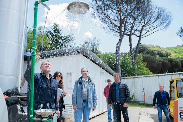 Auditors inspect an eye-wash station at Admiral Robert B. Carney Park in Pozzuoli, Italy,