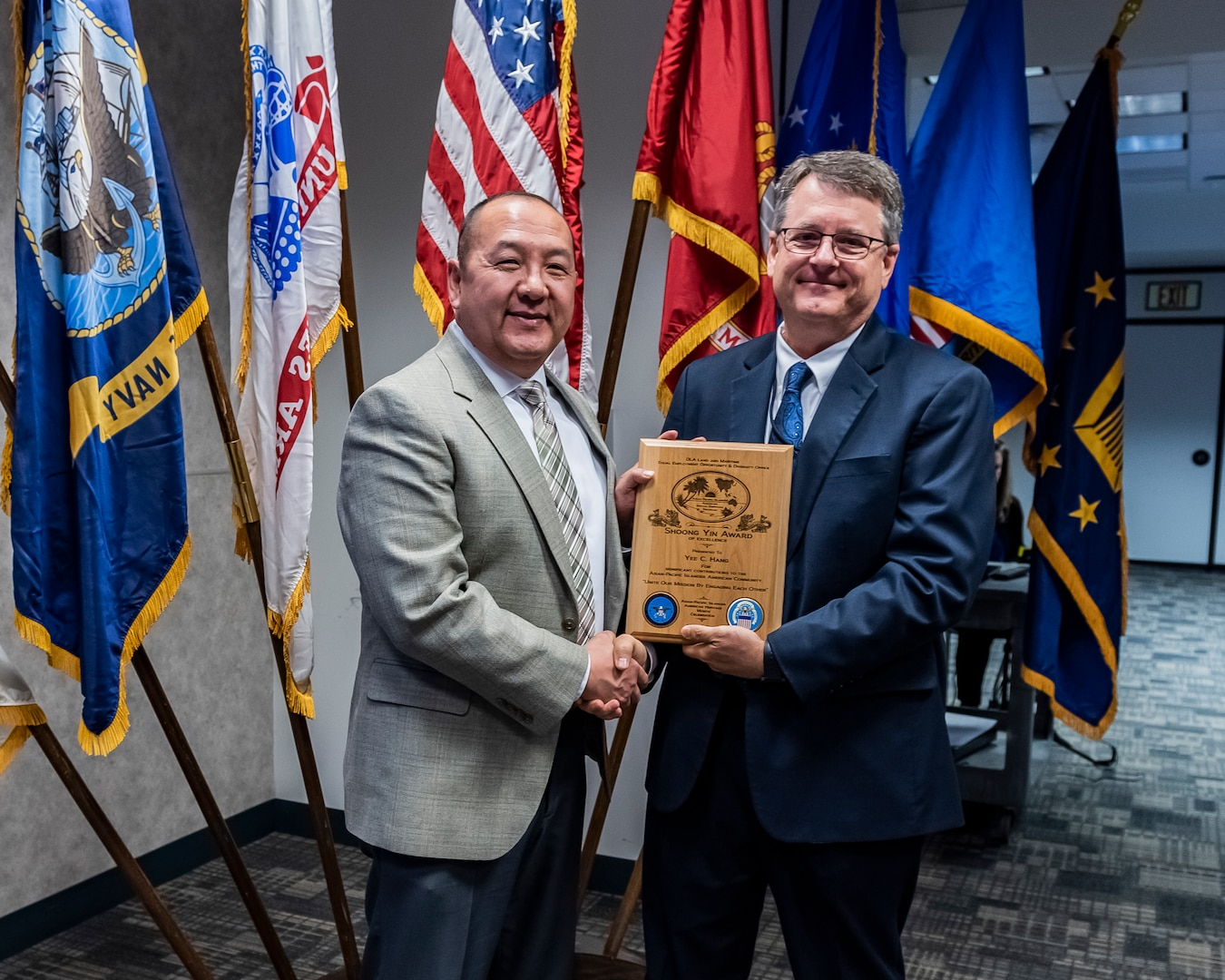The Shoong Yin award winner being presented with the award by a member of the DLA Land and Maritime command staff.