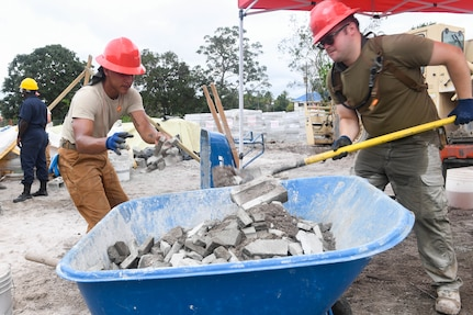 U.S. Air Force engineers clean debris at a construction site in Guyana.