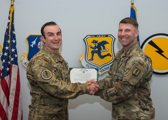 Master Sgt. Mitchell Smardz (left), 103rd Airlift Wing loadmaster, receives the Army Commendation Medal from Capt. Ryan Michalak, Connecticut Army National Guard Fitness Improvement Manager, May 28, 2019 Bradley Air National Guard Base, Conn. Smardz was recognized for his hard work after becoming a Master Fitness Trainer and working with the Fitness Improvement Program. (U.S. Air National Guard photo by Staff Sgt. Steven Tucker)