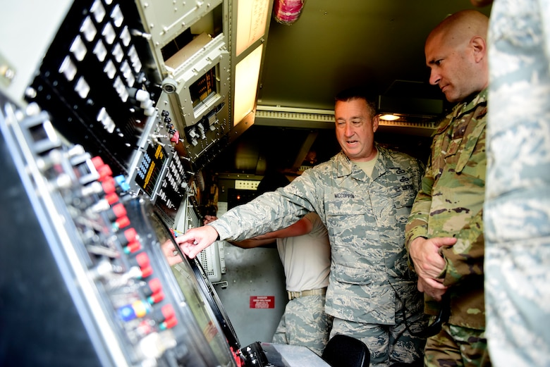 U.S. Air Force Master Sgt. Heath McCoppin, 123rd Air Control Squadron Electronic Protection Technician, explains TPS-75 radar operations to Chief Master Sgt. Toby Roach, 31st Operations Group Superintendent at Pula Airport, Croatia, May 28, 2019. Members of the 123rd Air Control Squadron, an Ohio Air National Guard unit, is augmenting the 606th Air Control Squadron during exercise Astral Knight 2019. (U.S. Air Force photo by Staff Sgt. Tory Cusimano)