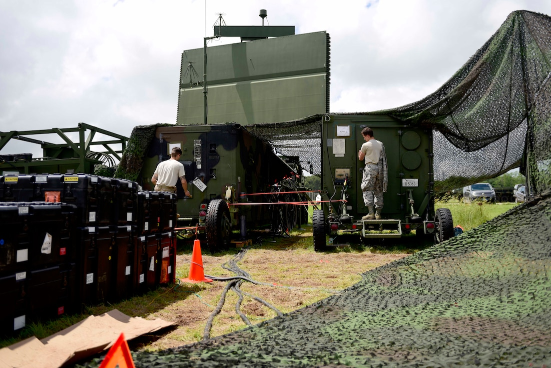 Airmen from the 606th Air Control Squadron prepare for work on the TPS-75 radar system at Pula Airport, Croatia, May 28, 2019. The 606th ACS is in Croatia to support Astral Knight 2019, which aims to demonstrate the integration, coordination, and interoperability of joint existing command and control at the operation and tactical levels. (U.S. Air Force photo by Staff  Sgt. Tory Cusimano)