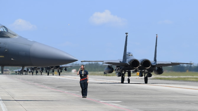 A 494th Aircraft Maintenance Unit crew chief salutes an F-15E Strike Eagle aircrew at Tyndall Air Force Base, Florida, May 20, 2019. The 494th AMU participated in exercise Checkered Flag 19-1, allowing maintenance personnel assigned to the 494th AMU to be evaluated through the Weapons Systems Evaluation Programs verifying weapon system performance, determine reliability, evaluate capability . (U.S. Air Force photo by Airman 1st Class Shanice Williams-Jones)
