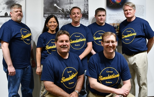IMAGE: KING GEORGE, Va. (May 22, 2019) – Members of the NSWCDD Combat System Simulators team are pictured at the first annual Modeling and Simulation Summit sponsored by the Naval Surface Warfare Center Dahlgren Division. Front row left to right: Randy Johnson and Mark Vogel. Back row left to right - James Herin, Beth Tran, James Bowling, James Flowers, and Bob Cunningham