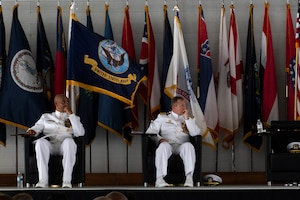 U.S. Navy leadership listens to the VFA-101 deactivation ceremony speaker Eglin Air Force Base, Florida, May 23, 2019.