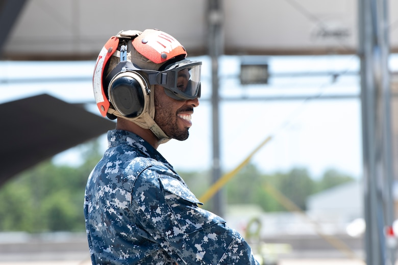 A U.S. Navy Sailor smiles during the preflight inspection of VFA-101's last F-35C Lightning II to depart Eglin Air Force Base, Florida, May 23, 2019.