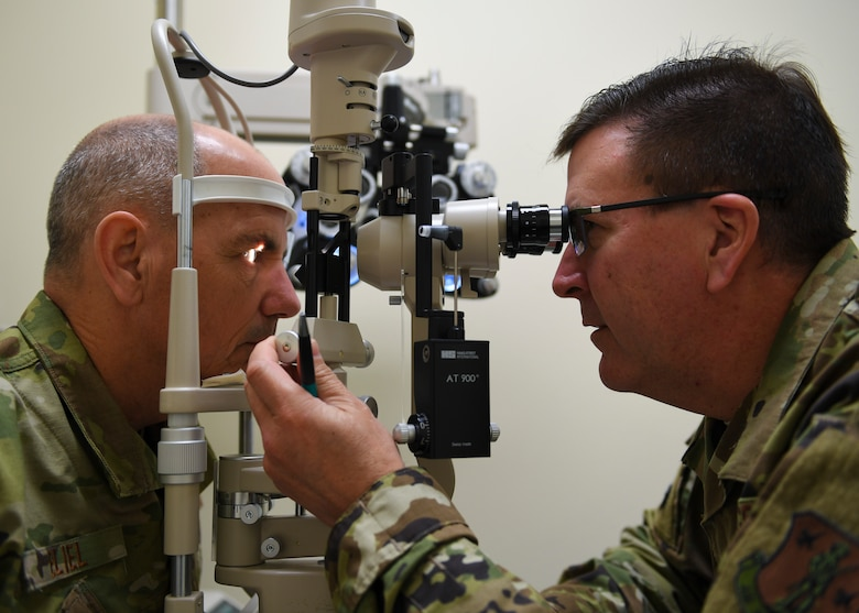 Washington Air National Guard Lt. Col. Robert Forbes (right), 194th Medical Group optometrist, tests Lt. Col. Erik Eliel (left), 194th Air Support Operations Group director of operations, vision during a 194th Medical Group periodic health assessment rodeo, Camp Murray, Washington, May 4, 2019. The PHA rodeo meets requirements to maintain an Airman's deployable status by giving immunizations, blood lab draws, HIV screening, and health assessment questionnaires. (U.S. Air National Guard photo by Senior Airman Justyn M. Freeman)