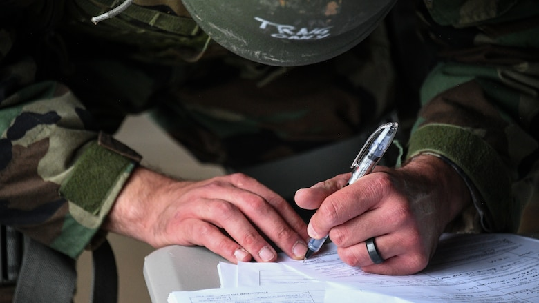 An Airman fills out paperwork during a Contracting Directorate field exercise at Hill Air Force Base, Utah, May 22, 2019. The exercise simulated scenarios specific to the contracting mission in a deployed environment. Contracting specialists purchase supplies and services essential to operational continiuty and mission success. (U.S. Air Force photo by R. Nial Bradshaw)