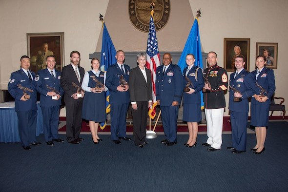 Secretary of the Air Force Heather Wilson and Lt. Gen. Anthony Cotton, Air University commander and president, both center, stand with recipients of the 2019 Secretary of the Air Force Leadership Award May 14, 2019, at Maxwell Air Force Base, Alabama. Secretary Wilson met with the recipients during her final visit to Maxwell AFB and AU as the Secretary of the Air Force.