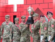 1st Lt. Terence Hughes and Capt. John Baer, Team 17, 39th Brigade Engineer Battalion, hold the first place trophy after being announced as the winners of the 2019 Best Sapper Competition, at Fort Leonard Wood, Mo.