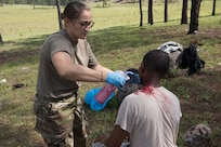 U.S. Army Master Sgt. Melinda Gates, Joint Task Force – Bravo Medical Element NCO-in-charge of EMT, creates simulated wounds on participants of a search and rescue exercise May 21, 2019, in Comayagua, Honduras. Members from various units on Joint Task Force – Bravo participated in the exercise that simulated a HH-60 Blackhawk crashed during a routine flight carrying personnel. The exercise practiced notification, recall, search and rescue, on-scene medical care, recovery of personnel from low and high angle austere terrain, and medical care once the injured returned to base. (U.S. Air Force photo by Staff Sgt. Eric Summers Jr.)