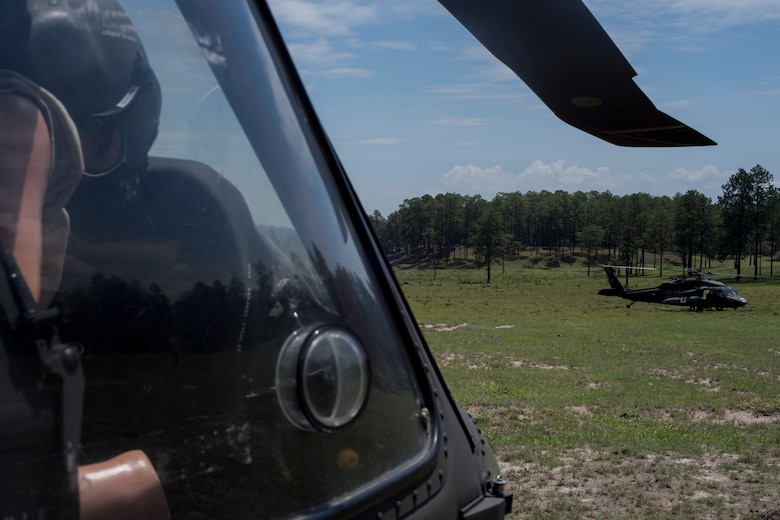 A HH-60 Blackhawk lands at the site of a simulated aircraft crash during a search and rescue exercise May 21, 2019, in Comayagua, Honduras. Members from various units on Joint Task Force – Bravo participated in the exercise that simulated a HH-60 Blackhawk crashed during a routine flight carrying personnel. The exercise practiced notification, recall, search and rescue, on-scene medical care, recovery of personnel from low and high angle austere terrain, and medical care once the injured returned to base. (U.S. Air Force photo by Staff Sgt. Eric Summers Jr.)
