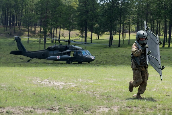 A U.S. Army medic carries a stretcher to the location of a simulated aircraft casualty during a search and rescue exercise, May 21, 2019, in Comayagua, Honduras. Members from various units on Joint Task Force – Bravo participated in the exercise that simulated a HH-60 Blackhawk crashed during a routine flight carrying personnel. The exercise practiced notification, recall, search and rescue, on-scene medical care, recovery of personnel from low and high angle austere terrain, and medical care once the injured returned to base. (U.S. Air Force photo by Staff Sgt. Eric Summers Jr.)