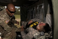 U.S. Army Sgt. 1st Class Phillip Webb, 1st Battalion 228th Aviation Regiment detachment first sergeant, feels for the pulse of a simulated aircraft casualty during a search and rescue exercise, May 21, 2019, in Comayagua, Honduras. Members from various units on Joint Task Force – Bravo participated in the exercise that simulated a HH-60 Blackhawk crashed during a routine flight carrying personnel. The exercise practiced notification, recall, search and rescue, on-scene medical care, recovery of personnel from low and high angle austere terrain, and medical care once the injured returned to base. (U.S. Air Force photo by Staff Sgt. Eric Summers Jr.)