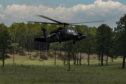 A HH-60 Blackhawk from the 1st Battalion 228th Aviation Regiment lands at a simulated aircraft crash to receive casualties during a search and rescue exercise, May 21, 2019, in Comayagua, Honduras. Members from various units on Joint Task Force – Bravo participated in the exercise that simulated a HH-60 Blackhawk crashed during a routine flight carrying personnel. The exercise practiced notification, recall, search and rescue, on-scene medical care, recovery of personnel from low and high angle austere terrain, and medical care once the injured returned to base. (U.S. Air Force photo by Staff Sgt. Eric Summers Jr.)