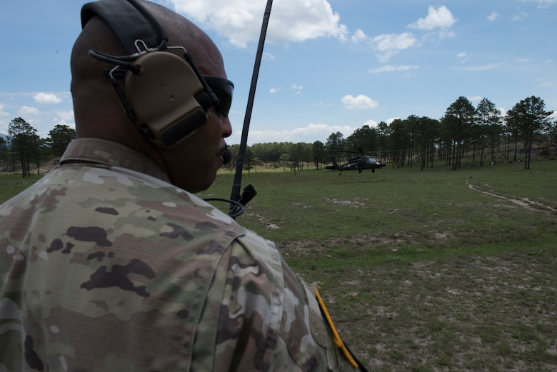 U.S. Army Sgt. 1st Class Phillip Webb, 1st Battalion 228th Aviation Regiment detachment first sergeant, alerts of simulated aircraft casualties during a search and rescue exercise, May 21, 2019, in Comayagua, Honduras. Members from various units on Joint Task Force – Bravo participated in the exercise that simulated a HH-60 Blackhawk crashed during a routine flight carrying personnel. The exercise practiced notification, recall, search and rescue, on-scene medical care, recovery of personnel from low and high angle austere terrain, and medical care once the injured returned to base. (U.S. Air Force photo by Staff Sgt. Eric Summers Jr.)