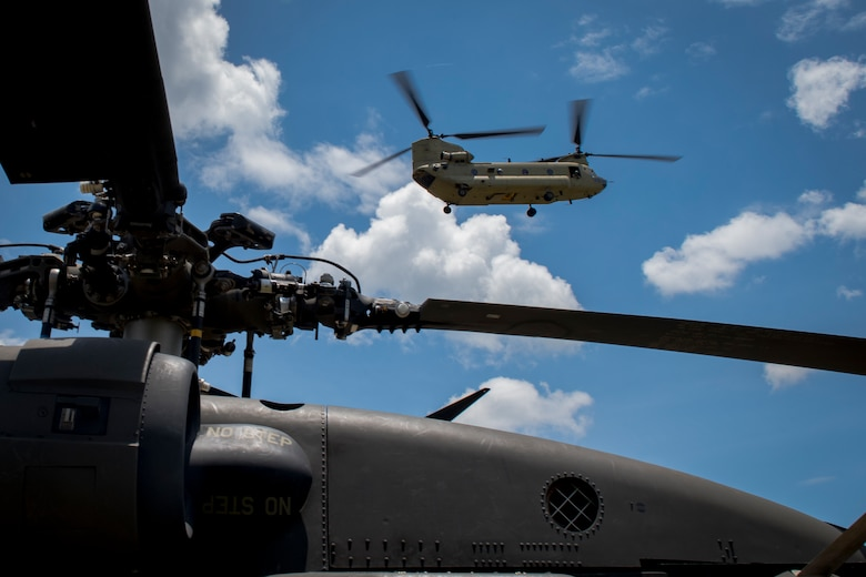A CH-47 Chinook from the 1st Battalion 228th Aviation Regiment, carrying first responders, arrives at the scene of simulated helicopter crash during a search and rescue exercise, May 21, 2019, in Comayagua, Honduras. Members from various units on Joint Task Force – Bravo participated in the exercise that simulated a HH-60 Blackhawk crashed during a routine flight carrying personnel. The exercise practiced notification, recall, search and rescue, on-scene medical care, recovery of personnel from low and high angle austere terrain, and medical care once the injured returned to base. (U.S. Air Force photo by Staff Sgt. Eric Summers Jr.)