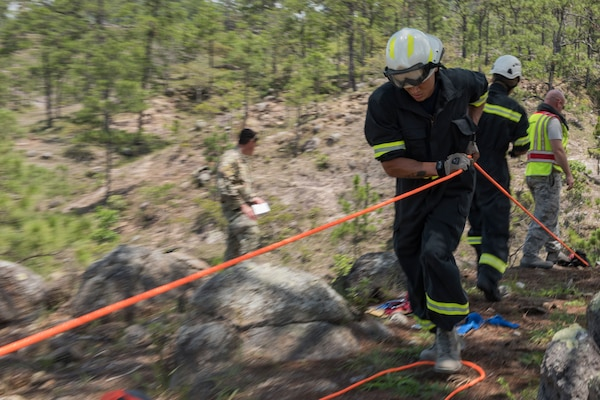 U.S. Air Force Staff Sgt. Spencer Highsmith, 612th Air Base Squadron firefighter, uses a rope to help raise a gurney during a search and rescue exercise, May 21, 2019, in Comayagua, Honduras. Members from various units on Joint Task Force – Bravo participated in the exercise that simulated a HH-60 Blackhawk crashed during a routine flight carrying personnel. The exercise practiced notification, recall, search and rescue, on-scene medical care, recovery of personnel from low and high angle austere terrain, and medical care once the injured returned to base. (U.S. Air Force photo by Staff Sgt. Eric Summers Jr.)