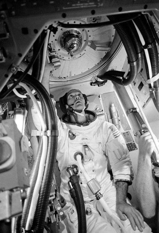 Apollo 11 Command Module Pilot and USAF Col. (later Maj. Gen.) Michael Collins trains in his A7L suit. The circular hatch above his head is at the top of the cone-shaped Apollo spacecraft.(Contributed photo)