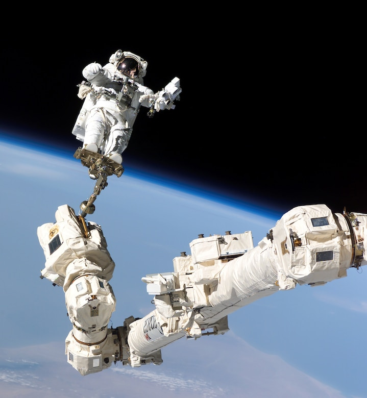 The Space Shuttle's robotic arm served as a work platform for astronauts.(Contributed photo)