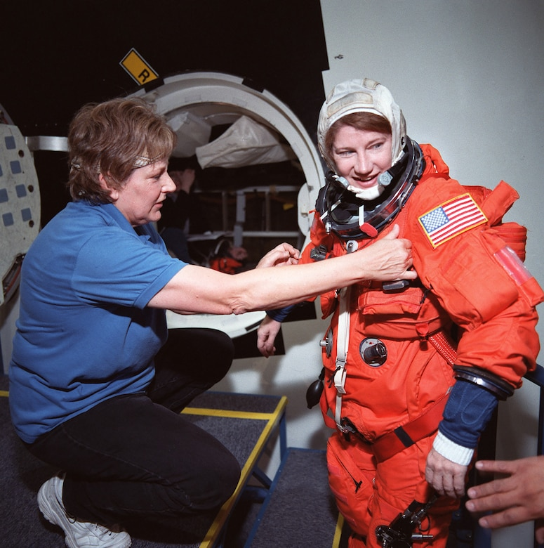 Air Force astronaut Col. (later Lt. Gen.) Susan J. Helms prepares for Space Shuttle training in an ACES suit before mission STS-101, March 7, 2000.(Contributed photo)