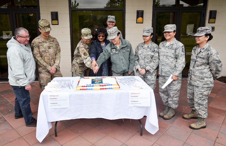 "The Asian American Pacific Islander Committee cuts a cake to celebrate the start of the heritage month, May 1, 2019 at Joint Base McGuire-Dix-Lakehurst, New Jersey. This year's theme was ""Unite our mission by engaging each other"", the phrase captures the leadership, inclusion, persistence, relationships, effort, and dedication of Asian Americans and Pacific Islanders throughout the United States. (U.S. Air Force photo by Staff Sgt. AJ Hyatt)"