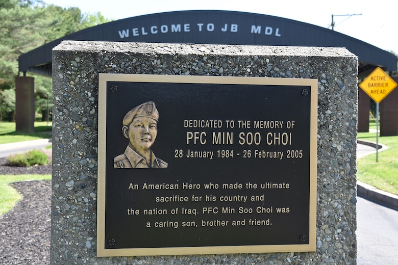 A memorial plaque dedicated to Private First Class Min Soo Choi sits in front of Joint Base McGuire-Dix-Lakehurst's Wrightstown Gate entrance. The Asian American Pacific Islander Heritage Committee honored Choi's memory by sharing his story during their 2019 May AAPIH Celebration on May 20, 2019 at Joint Base MDL, New Jersey. (U.S. Air Force photo by 1st Lt. Jaclyn Sumayao)