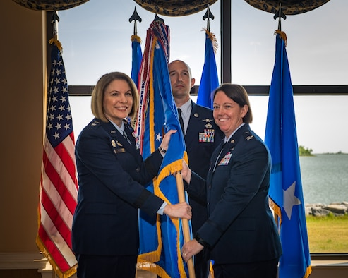 U.S. Air Force Maj. Gen. Mary F. O'Brien, Twenty-Fifth Air Force commander, passes the guidon to Col. Melissa A. Stone during the 363d Intelligence, Surveillance and Reconnaissance Wing assumption of command ceremony at Joint Base Langley-Eustis, Virginia, May 30, 2019. The 363d ISRW conducts lethal, resilient and ready operations across four key mission areas: analysis of air, space and cyber operations; full-spectrum targeting; special operations ISR; and ISR testing, tactics development and advanced training. (U.S. Air Force photo by Senior Airman Nin Leclerec)
