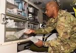 Senior Airman Gibbs Bellamour, 5th Medical Operations Squadron aerospace medical technician, organizes supplies in an ambulance storage space at Minot Air Force Base, North Dakota, April 4, 2019.