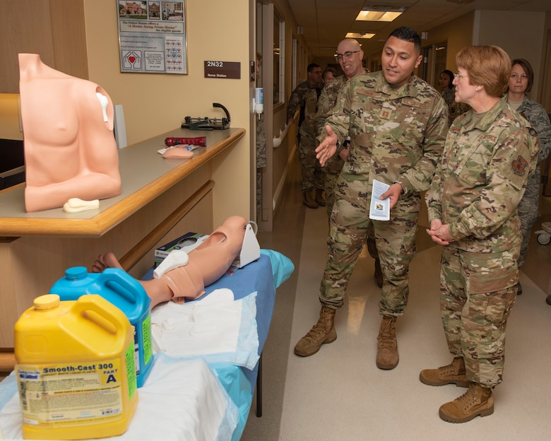 U.S. Air Force Capt. Christopher Minor, 88th Medical Group registered nurse, shows Lt. Gen. Dorothy A. Hogg, U.S. Air Force Surgeon General, custom-made prosthetics made for the patient simulation lab at Wright-Patterson Air Force Base Medical Center, Ohio, May 23, 2019. Hogg toured various locations in the hospital, such as the emergency medicine department, diagnostic imaging, operating room, simulation center, and medical-surgical unit. (U.S. Air Force photo by Michelle Gigante)